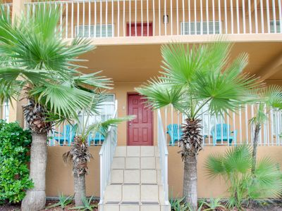 Photo for Casual, half block from the beach w/ two patios, shared pool!