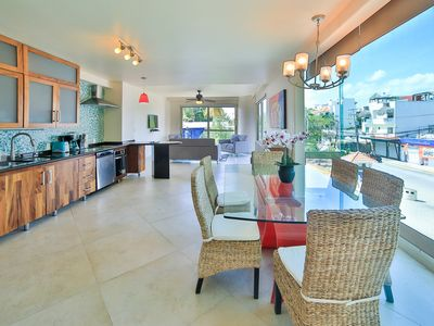 Photo for Condo with 3 balconies overlooking 5th Ave. 4 minute walk to the beach!