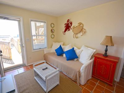 Cute, relaxing 1-bedroom oceanfront condo located directly on the Boardwalk with free WiFi and a stunning ocean view!