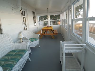 Enclosed porch (Air Conditioned/Heated) and Screen Windows