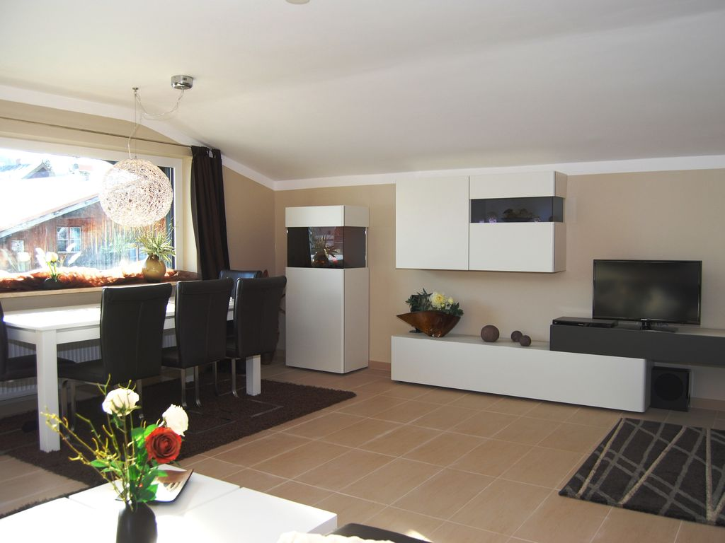 Seefeld Apartment Rental   Living Room With A Spacious Dining Area And A  Cozy Electric Fireplace