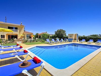 Photo for 8 bedroom Villa, sleeps 16 with Pool, Air Con and Walk to Shops