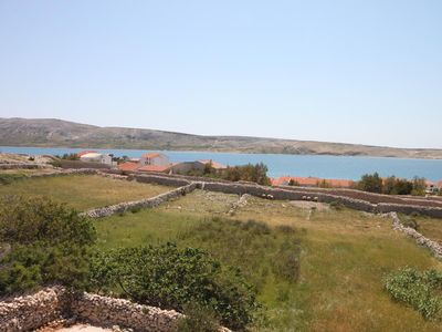 Photo for One bedroom apartment with terrace and sea view Kustići (Pag)