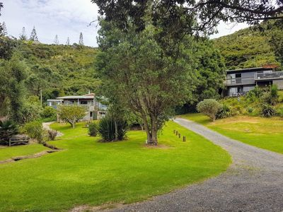 Photo for Two beachfront properties in stunning private bay