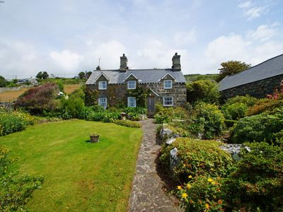 Photo for Experience a touch of magic in this charming and pretty traditional Welsh cottage in the heart of th