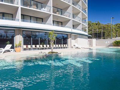 Photo for 211 'The Landmark', 61B Dowling Street - Resort Style holiday with pool, games room & restaurant