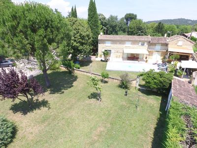 Photo for Provencal farmhouse renovated in the countryside with pool, 10 minutes from downtown!