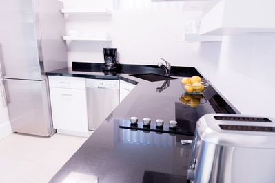 Modern kitchen with stainless steel appliances.