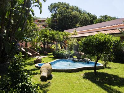 Photo for Romantic apartment in a villa by the sea, with private beach and swimming pool