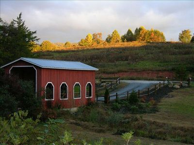 Entrance is our red covered bridge and you'll pass our pond and waterfall.