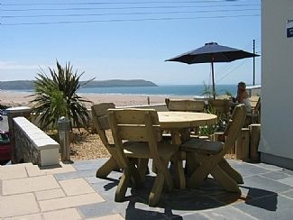 Photo for Apartment Next To The Beach And Within 200 Yards Of The Village Centre