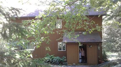 Photo for Lovely hand-crafted cottage in the woods that sleeps 6.