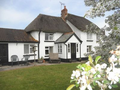 Photo for Picturesque detached thatched  cottage in beautiful Mid-Devon countryside.
