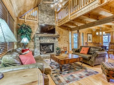 Photo for Inviting hillside cabin w/ private hot tub, fireplace, pool table & Ping-Pong!