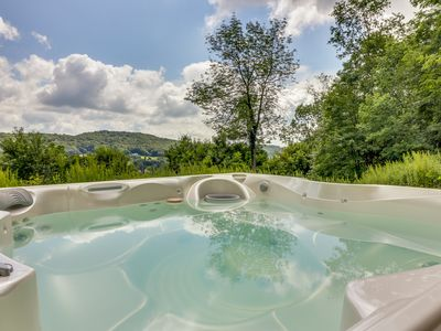 Photo for Spacious home w/ private hot tub & incredible view of the lake - close to skiing