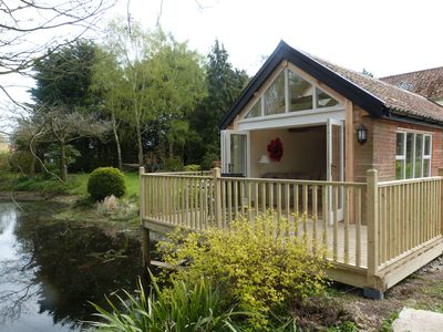 Photo for Fabulous boutique cottage for 2 people overlooking a large pond and gardens