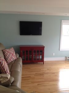 Flat screen TV in living room with direct TV channels available
