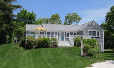 Photo for Just a quick walk to popular Ridgevale Beach from this 4 bedroom, 3 bath cottage!