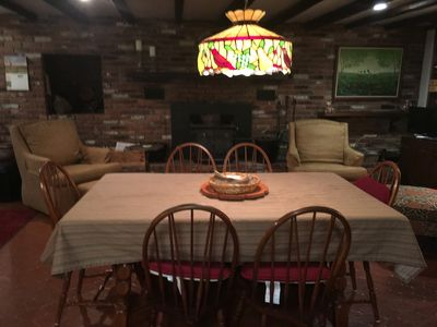 dining area with wood burning stove on far wall