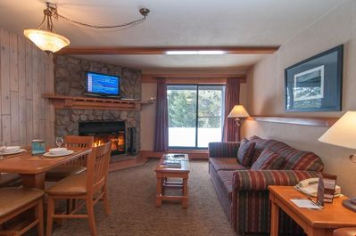 Snuggle up on the comfortable sofa in front of the wood-burning fireplace (wood provided!)