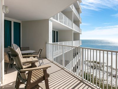 Photo for Beachfront condo w/ access to pools, hot tubs, sauna & fitness center!