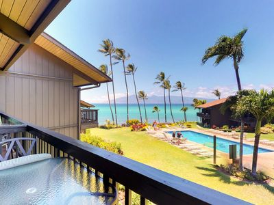 Photo for Renovated oceanfront getaway w/ great views, shared pool, & tropical vibes