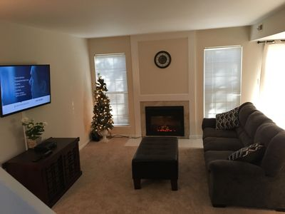 Family room with fireplace and 48in Smart TV