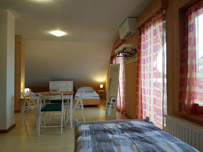 room with 4 single beds and air condition