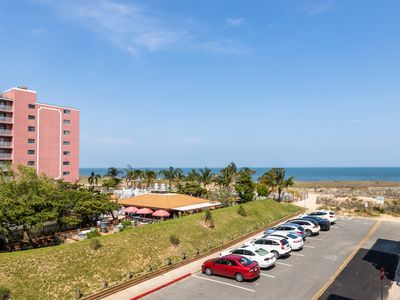 Photo for Ocean view steps from the beach w/ balcony & shared pool - 2 dogs OK!