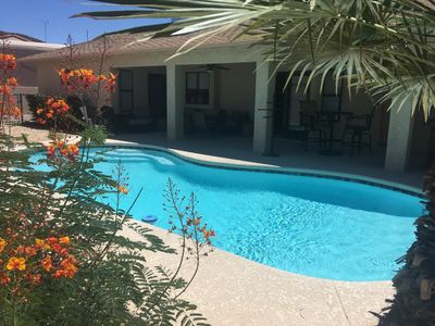 Photo for Relax in a newly renovated,  heated pool home w/ BBQ bar and entertainment patio