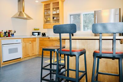 Kitchen, fully equipped, coffee station, island prep area, recycling cupboard.