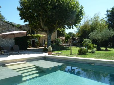 Photo for At the foot of the Luberon, authentic 18th century Mas. stone with pool