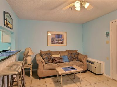 Photo for Comfortable studio condo with shared pool and hot tub - walk to the beach!