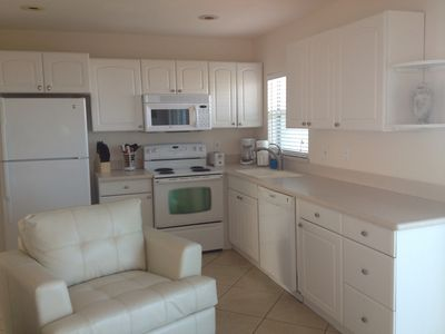 Full size kitchen with pots/pans, dishes, coffee maker, microwave and dishwasher