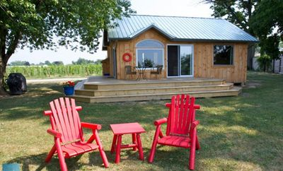 View of Lake Ontario from these comfy chairs in front of our Lake House cottage