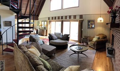 Comfy great room with TV/stereo--perfect for family gatherings and lake viewing.