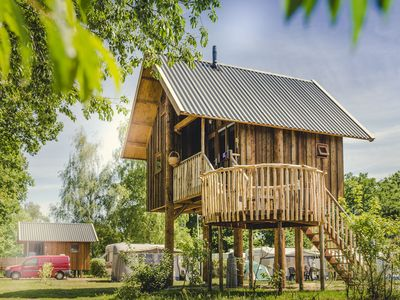 Photo for Beautiful treehouse with a terrace, at the river De Regge