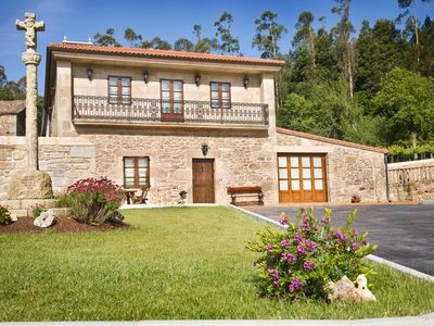 Photo for INTEGRATED RENTAL. For a little more, something special. 15 m away from Santiago and 10 beach