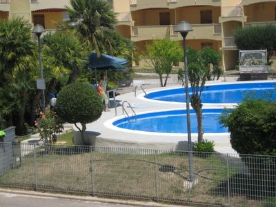 Photo for Alghero Lido beach front home with pool