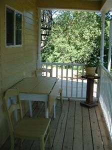 Enjoy a hot cup of coffee or a cold glass of lemonade on Dolly's front porch.