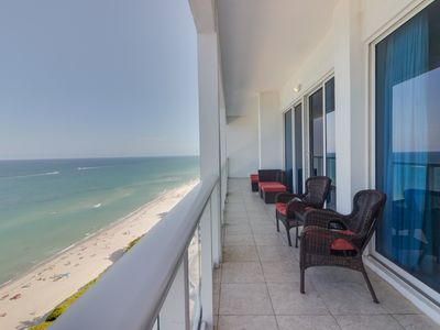 Photo for Oceanfront penthouse w/ shared pool, gym, bars, beach access!