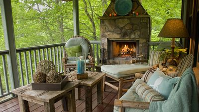 Outdoor fireplace on porch overlooking River