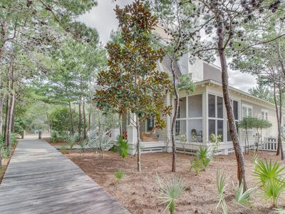 Photo for Lovely beach house with shared pool, patio, gas grill, and fireplace!
