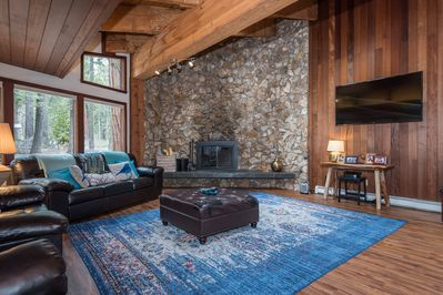 """Great room with plenty of windows, wood accents, soaring beamed ceilings and a just added 70"""" flatscreen TV"""