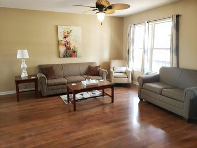 Spacious living room contains pull out couch and TV