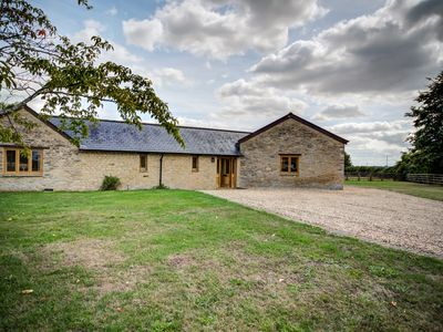 Photo for LOWER FARM BARN, pet friendly, with a garden in Bampton, Ref 992282