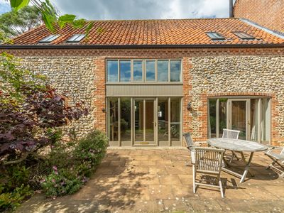 Photo for A very spacious barn conversion offers a wonderfully peaceful location.