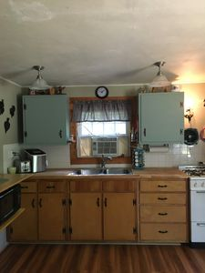 Kitchen is packed with appliances and plenty of serving for large crowds.