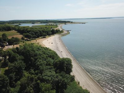Drone photo taken directly above home w/ view of Town Beach & Colt State Park.