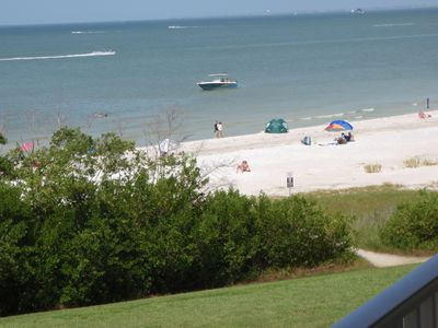 This is the view from the Lanai. The beach is a short walk through the lawn 100'